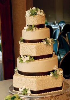 Ivory Multi-Tiered Cake with Green & White Flowers