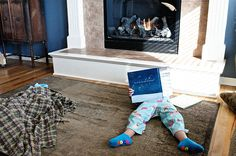 Leah reading by the fire.  Love this.