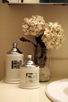 relaxing guest bathroom -love the jars