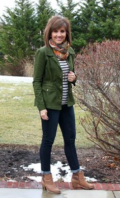 Cyndi Spivey from Grace + Beauty pairs a striped top and military jacket with jeans.