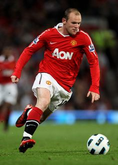 Wayne Rooney of Manchester United in action during the Barclays Premier League match between Manchester United and Newcastle United at Old Trafford on August 16, 2010 in Manchester, England.