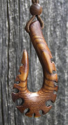 """Russian Olive Carved Tribal Warriors Fishing Hook, 1"""" x 2"""" x 1/4"""" thick, with Carved 1/4"""" Russian Olive Bead. by ArtfromtheWoods on Etsy"""