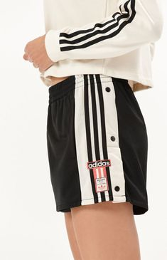 Take the retro-inspired Adibreak Shorts out for a spin on your next run. adidas deliver these comfy short with the iconic down the sides with snap-button closure, elastic waistband, single back pocket, and side pockets. Comfy Shorts, Adidas Shorts, Fashion 2018, Piece Of Clothing, Pacsun, Get Dressed, Skor, Buttons, How To Wear