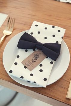 polka dot napkin with black bow tie and kraft name card. classic and modern at the same time.