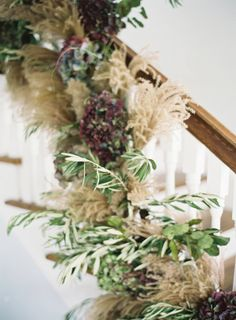 Winter Garland on Stairs of grasses and dried hydrangea by White Magnolia Designs www.WhiteMagnoliaDesigns.com photography by http://www.michaelandcarina.com