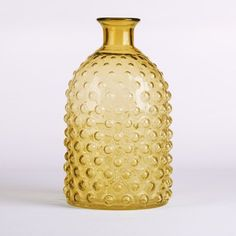 Glitzhome Handblown Hobnail Tabletop Glass Vase 11.61 Inch, Amber. This vase is a simple way to bring a pop of color into your space. Cool hobnail exterior will accent any design. Dimension - 6.89 x 6.89 x 11.61 in. Item Weight - 4.54 lbs.