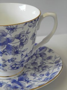 blue + white floral teacup. I have this tea set for one that includes a little teapot, creamer & open sugar bowl AND lovely tray...all matching.