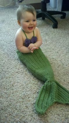 my daughter in a mermaid outfit that a friend made :)