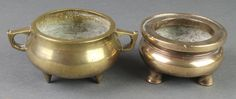 """Lot 303, A circular Chinese bronze censer raised on 3 feet, the base with seal mark 2"""" and a twin handled ditto 3"""", sold for £240"""