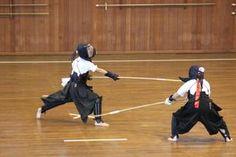 Naginata-fighting, two Japanese girls fighting with Naginata, a long sword