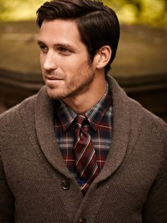 Layer a traditional cardigan with a button up and tie - great business casual look!