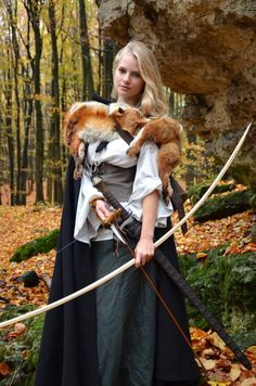 Parts of this maidens outfit is authentic. Like the skirt, cape, and bodice. Archery was a hobby for noble women in the 16th century.