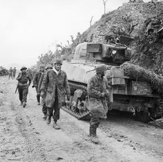 BRITISH ARMY ITALY 1944 (NA 12912)   Captured German parachute troops file past a Sherman tank of the New Zealand 4th Armoured Brigade at Cassino, 16 March 1944.