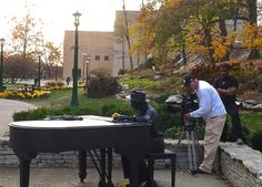 Nov. 9, 2012. There is no shortage of scenic views on the Bloomington campus to attract amateur and professional memory makers alike. Here, a crew from ESPN sets up over the shoulder of a sculpture of local music legend Hoagy Carmichael to get a shot of IU Cinema for a piece that aired during a recent IU football game shown by the network. Photo by Mark Land.