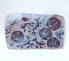 sgraffito kelp   sand dollars and seaweed hand carved ceramic art by crowfootstudio