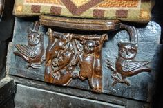 Turning the Tables. Three rats hang a cat. The owls either side are ready to pounce, Misericord, Great Malvern Priory (by Julian P Guffogg, geograph.co.uk 3087091 5a7eeb63) - Category:Misericords in England - Wikimedia Commons