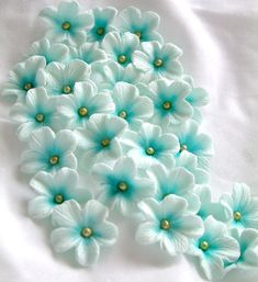 Gumpaste Cake Decorations Tiffany Blue Gum Paste Flowers 25 piece set. $10.00, via Etsy.