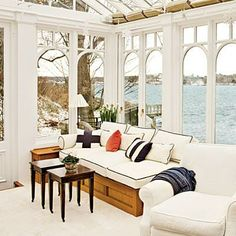 We love the built-in furnishings in this wood-and-glass conservatory.