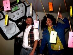 80's Party Decorations...I do still have tons of cassette tapes... Thread some curling ribbon through the holes and hang from the ceiling?!
