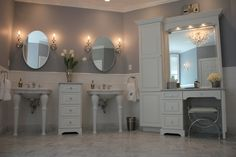"Our new master bath. Paint -Behr French Silver. Sinks -St. Thomas Creation Parisian 28"" with china legs. Wall sconces-Schinbek Jasmine. Chandelier-Schonbek Renaissance. Drawers"