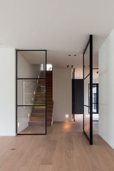Elegant glass pivot door system made from anodised aluminium. Portapivot offers made-to-measure hardware systems for pivot doors, sliding doors and fixed glass partitioning systems. Pivot Doors, Sliding Doors, Design Case, Beautiful Bathrooms, Interior Design Living Room, New Homes, Room Decor, Glass Partition, Partition Door