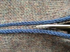 cutting = STEEKING!!  Great article here from CowTownKnits blogsite and Yes!  Confirms my scary feelings about attempting to steek ....... recommends a machine sewn stitch first before cutting and crocheting ~ this article is giving me more confidence to try this technique.
