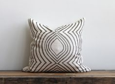Aya Contour metallic silver pillow cover hand printed on off-white organic hemp 20x20. $70.00, via Etsy.