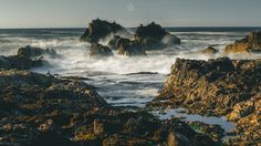 Take the Rough with the Smooth - A long exposure, landscape image of gulls sitting on rocks, being hit by waves at sunset off Portknockie in Morayshire, Scotland.