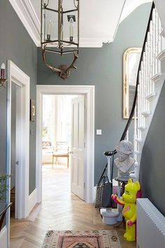 Farrow and Ball Lamp Room Grey The slight blue undertones of this classic grey Farrow and Ball paint give an elegant feel to a period hallway. Modern Country Style: The Best Paint Colours For Small Hallways Click through for details. Hallway Colours, Room Colors, Hall Paint Colors, Colour Schemes For Hallways, Living Room Wall Colours, Hall Colour, Decoration Hall, Victorian Hallway, Flur Design