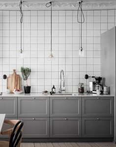 I love the metro tiles with black grout in this Swedish kitchen. It gives the soft grey fronts a more industrial look, which is made more delicate with the whiskey flask lamps above the counter. The layout of the kitchen … Continue reading → Quirky Home Decor, Cheap Home Decor, String Shelf, Swedish Kitchen, Kitchen Words, White Tiles, Minimalist Decor, Wall Tiles, Blog Design