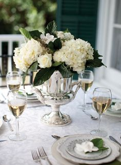 Love the idea of various silver colored containers with flowers on some of the tables. Could even paint glass vases silver.  centerpiece in silver | Nancy Ray #wedding