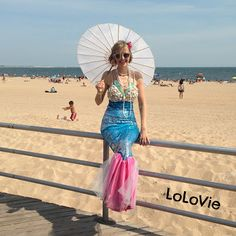 Mermaid Halloween costume by LoLovie  She gives a free tutorial for both an adult and a young child's homemade Mermaid outfit.  Easy!!