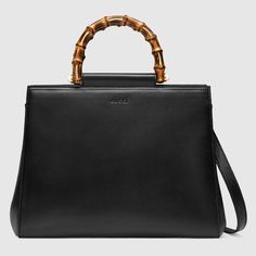 NYFW - 1 - Creatures Of The Wind - Bag styling: (Gucci Nymphaea leather top handle bag)