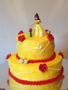 Beauty and the Beast birthday cake. Yellow with red roses