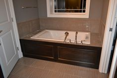 pics of tubs with wood surround | We also got our first peek at the tub surround in place: