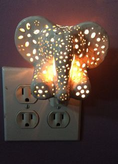 This is a hand carved ceramic elephant night light approximately 3 inches tall and 4 inches wide. It is a perfect addition to any nursery or childs room. Colors:-Sky Blue-Cotton-Gray-Pig Pink-Robins Egg-Lilac Each elephant includes a light with an ON/OFF switch that plugs directly into the wall.