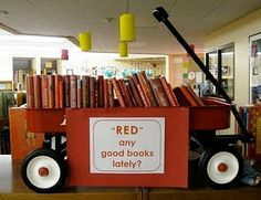 """cute idea for a library display. """"Red"""" any good books lately? And I totally have wagons in my library already."""