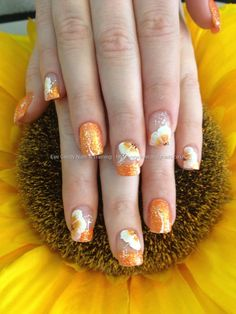 Orange glitter tips with one stoke flowers on acrylic nails  These are beautiful Spring / Summer nails! This is classy not trashy nail art in my opinion. If I wore acrylics I would love to have this! Maybe 1 of my customers will