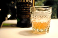 Godfather, a venerable old classic involving 2 parts (or 3 parts) Scotch to 1 part amaretto, stirred over ice.