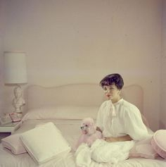 Joan Collins with a pink poodle,1955 fabulous photographer slim aarons