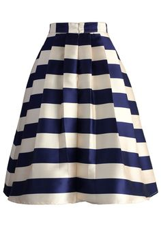 Sip tea and slay the masses in style wearing this flared midi skirt! With thick modern Scottish navy and ivory stripes presented with lovely pleats, this skirt is quite the subtle statement this fall. Slip into a simple knit top, heels and your biggest smile!  - Pleated silhouette - Back zip closure - Lined - 100% Polyester - Machine washable  Size(cm) Length Waist XS       68     66 S        68     70 M        68     74 L        68     78 XL…