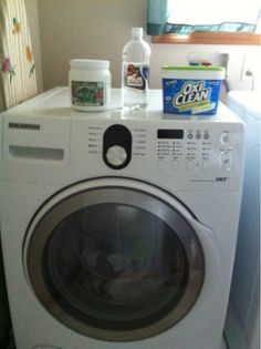 How to wash cloth diapers in HE front load washer. Blog post walks you through step by step how to wash cloth dipers in your home washer using non toxic eco and baby friendly products. These diapers can be tricky with a front load washer!