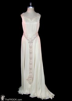 """Vintage 1930s silk chiffon over silk satin Grecian style wedding or evening gown with impressive art-deco beadwork on neckline, belt and pendant down center front skirt. Hidden side hook & eye closures. Excellent condition with only discreet wear, sleeveless bodice measures bust 35"""" and waist 27"""", the length is 59"""" at front but it trains about a foot longer at back. Incredible gown!"""