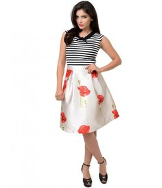 You won't be able to sit still, darling. Say hello to a pristinely constructed flare skirt in a demure poppy floral prin...Price - $37.00-80yzUwLm