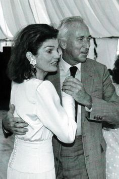 Jackie dancing with her half-brother, Hugh D. Auchincloss III, at the wedding reception of 28-year-old Caroline Kennedy, to 41-year-old Ed Schlossb...