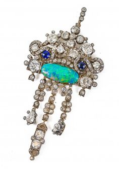 I just discovered this AN IMPORTANT AND VERY LARGE ANTIQUE OPAL, DIAMOND AND on LiveAuctioneers and wanted to share it with you: www.liveauctioneers.com/item/40315197