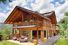 Architect Doug DeChant maximized every foot of the lot's narrow building envelope, and created a spacious upper deck and a main floor wraparound walk-out patio that extends the living area to the outdoors. PHOTO BY Gibeon Photography Bamboo House Design, Wooden House Design, House In Nature, House In The Woods, Asian House, Gypsy Home, Model House Plan, Wooden Cottage, Building A Container Home