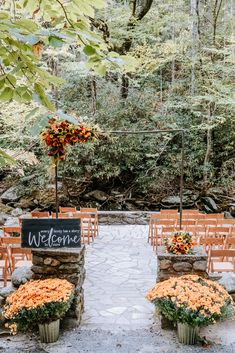 Bright oranges, yellows, reds and purples in the flowers | Huge orange mums | Wood welcome sign | Echelon Florist | Smoky Mountain Wedding | National Park Wedding | Fall Wedding | Spence Cabin Ceremony | Appalachian Clubhouse Reception | Derek Halkett Photography | Absolute Wedding Perfection
