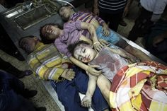 The bodies of four children from the al-Dallu family lay in a hospital after an Israeli missile struck a family home killing at least seven members of the same family in Gaza City on November Pray For Iraq, Adonai Elohim, Espanto, Gaza Strip, Innocent Child, New King James Version, Creative Pictures, Peace On Earth, Faith In Humanity