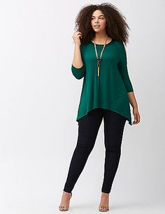 Sultry cold-shoulder tunic makes the ideal partner to your fave Fall leggings with its trendy shark bite hem. Soft knit with a satin-trimmed boat neck for that extra special finish. 3/4 sleeves. lanebryant.com